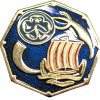The Anglia brooch with trefoil and ship on blue background
