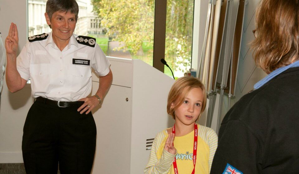 Police Commissioner Cressida Dick and a Brownie make a promise