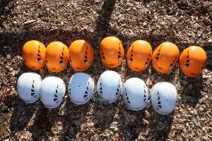 Hard hats for abseiling in orange and white