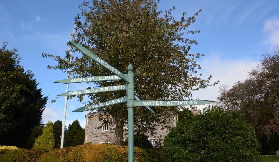 Signpost in front of Hautbois House directing people to activities