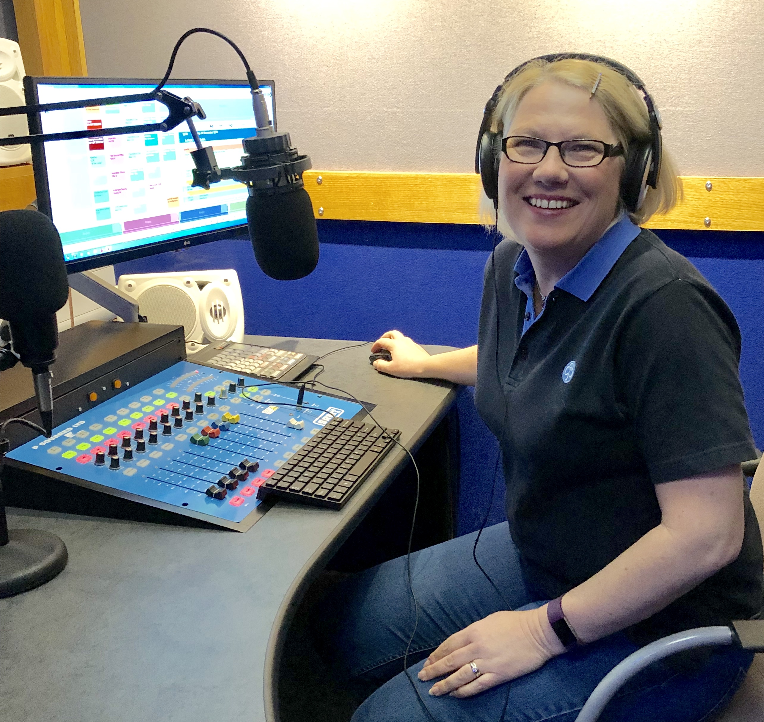 A guide leader in front of a radio broadcasting desk